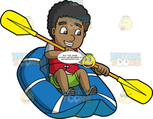A Black Man Having Fun Making His Way Through Rough Water In His Raft. A black man wearing green shorts, a grey t-shirt, and red life jacket, holds a double bladed paddle in both hands and uses it to steer his blue raft along a river