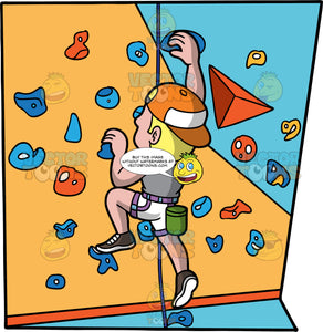 A Sporty Guy Climbing An Indoor Rock Wall. A man with blonde hair, wearing white shorts, a gray shirt, dark gray shoes, and a backwards orange baseball cap, climbing up an artificial rock wall