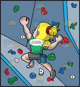 A Blonde Man Indoor Rock Climbing. A man with blond hair tied in a bun, wearing gray shorts, a green shirt, and white and purple rock climbing shoes, using the hand and foot holds to climb up a rock climbing wall