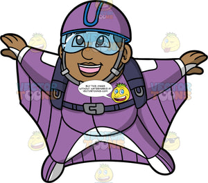 James Flying In A Purple Wingsuit. A black man wearing goggles and a protective helmet, spreading his arms and legs out as he flies through the air in a purple wingsuit