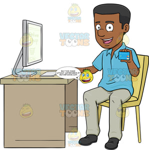A Black Man Using A Desktop Computer To Shop Online With A Credit Card