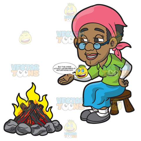 An Old Black Woman Sitting Beside The Campfire