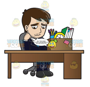 A Sad Mad Sitting At His Desk After Being Fired