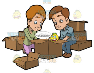 A Couple Arranging The Boxes They Will Use For Moving Out