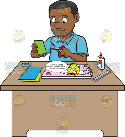 A Black Man Creating A Scrapbook