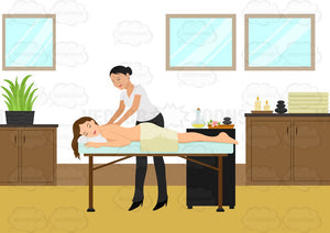 A Woman Relaxes While Having A Back Massage