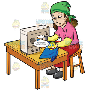 A Female Factory Worker Sewing A Pair Of Pants
