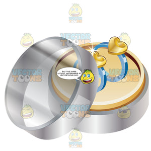 Two Silver Wedding Rings With Gold Hears In A Clear Case