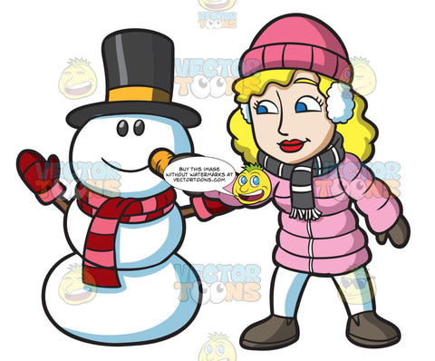 A Woman Placing A Carrot Nose On The Snowman