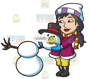 A Woman Placing The Head Of A Snowman On Top Of Two Snowballs
