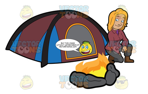 A Female Camper Looking At The Campfire