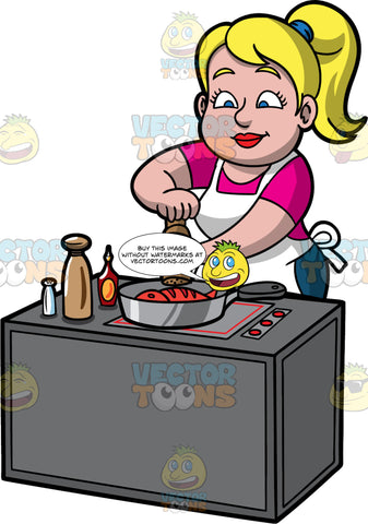 Pat Adding Pepper To The Food She Is Cooking. A blonde woman with blue eyes, wearing a pink shirt, blue jeans, and a white apron, standing behind a stove and using a pepper grinder to add some flavor to the fish cooking in the frying pan on the stove