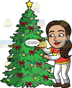 Isabella Putting Bows On A Christmas Tree. A Hispanic woman wearing white pants, an orange, yellow and white shirt, and brown shoes, putting small red bows on a Christmas tree