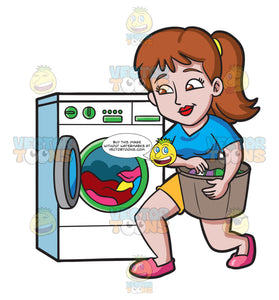 A Woman Placing Clothes In The Washing Machine
