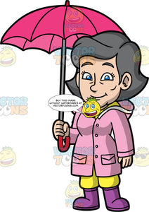 Mary Standing Under An Umbrella. A mature woman with gray hair and blue eyes, wearing a pink raincoat, and purple rain boots, standing under a pink umbrella