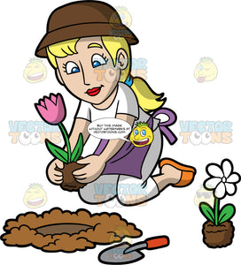 A Woman Planting A Flower In A Hole In The Ground. A blonde woman with her hair tied in a low ponytail, wearing white pants, a white shirt, a purple apron, orange shoes, and a brown sun hat, kneeling down and planting a pink tulip in a hole in the ground