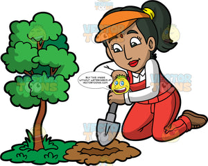 An Indian Woman Digging A Hole Next To A Small Tree. An Indian woman with black hair tied up in a ponytail, wearing red overalls over a white shirt, brown shoes, and an orange visor, kneeling down and using a small shovel to dig a hole next to a small tree