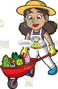 A Woman Pushing A Wheelbarrow Full Of Plants. A woman with curly brown hair and brown eyes, wearing white overalls over a purple t-shirt, blue shoes, yellow gloves, and a yellow sun hat, pushing a red wheelbarrow filled with a variety of plants