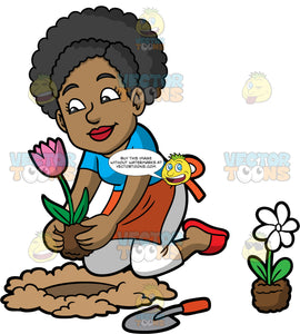 Jackie Planting A Tulip In The Ground. A stylish black woman, wearing white pants, a blue shirt, orange apron, and red shoes, kneeling on the ground and planting a pink tulip in a hole