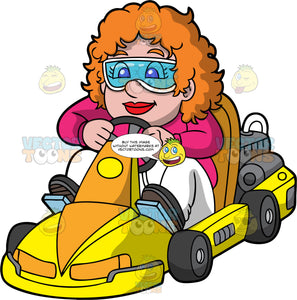 A Chubby Woman Having Fun Go-Karting. A woman with orange hair, wearing eye goggles, pink shirt and white pants, smiles as she drives a yellow and orange go-kart