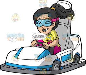 A Giddy Woman Driving Around The Track In A Go-Kart. A woman with black hair, wearing eye goggles, yellow shirt and pink pants, races around the track on a white and blue go-kart