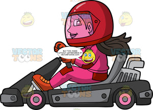 A Woman Races Around On A Black Go-Kart. A woman wearing a red full face helmet, pink and red racing suit, red racing gloves, and red boots, having fun racing her go-kart