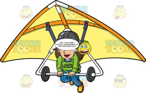 A Woman Preparing To Land A Hang Glider. A woman wearing a dark grey helmet, green jacket and blue pants, lowers her legs in preparation for landing the yellow hang glider she is strapped into