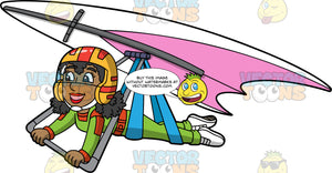 A Happy Black Woman Soaring Through The Air On A Hang Glider. A black woman wearing an orange and red helmet with visor, green jumpsuit and white shoes, hangs onto the bar of the pink and white hang glider she is strapped into