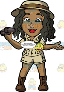 Maggy Dressed Up As An Archaeologist. A black woman wearing khaki shorts, a khaki shirt, brown boots, and a brown safari hat, standing and holding a pair of binoculars in her hand