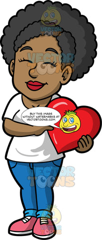 Jackie Holding A Big Heart. A black woman wearing blue pants, a white t-shirt, and pink shoes, standing with her eyes closed and holding a big heart in both her hands