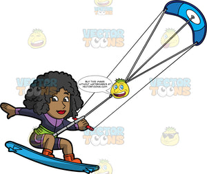 A Happy Black Woman Leaping Into The Air On Her Kitebaord. A black woman wearing a purple wet suit and orange boots, holds onto a power kite as her blue kiteboard lifts into the air