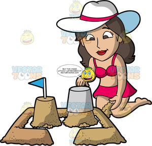 A Woman Emptying Buckets Of Sand To Create A Sandcastle. A woman with brown hair and eyes, wearing a pink two piece bathing suit, and white sun hat with pink stripe around the middle, kneeling down and empties a bucket of sand next to another sand structure with a flag on top of it