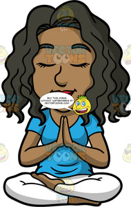 Maggie Sitting In Quiet Meditation. A black woman with long, wavy hair, wearing white pants, and a blue t-shirt, sitting on the floor with her legs crossed, eyes closed and palms pressed together in front of her chest