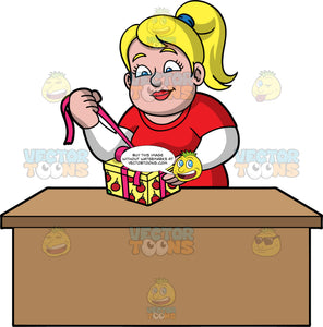 Pat Opening A Christmas Present. A chubby blonde woman wearing a red t-shirt ove a long sleeve white shirt, standing behind a table and pulling on a bow wrapped around a Christmas gift