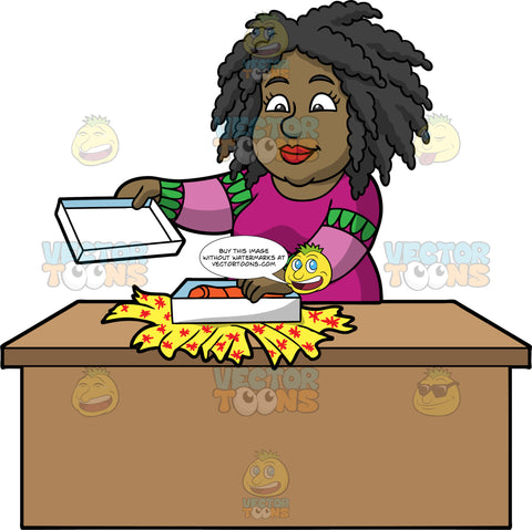 Lisa Opening A Gift She Received For Christmas. A black woman wearing a purple and green sweater, standing behind a table and opening a gift box