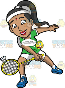 An Indian Woman Having Fun Playing Badminton. An Indian woman with black hair tied up in a ponytail, wearing white shorts, a green shirt, and blue shoes, hitting a shuttlecock with her yellow badminton racquet