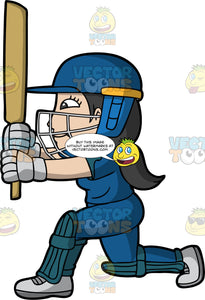 A Female Batter Holds Her Cricket Bat Up Ready After Hitting A Ball. A woman wearing a blue safety helmet, blue cricket uniform, grey shoes and gloves, and blue knee and shin pads, holds her cricket bat up in front of her face and kneels on one knee after just hitting a cricket ball