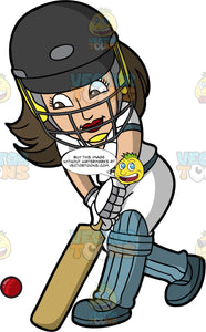 A Female Batter Expertly Hitting A Cricket Ball. A woman with brown hair, wearing a dark grey safety helmet, white uniform, grey and white gloves, dark grey shoes, and light blue shin and knee pads, lowers her arms and hits a cricket ball with the bat in her hands