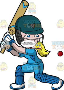 A Woman Crouches As She Gets Ready To Swing Her Bat At A Cricket Ball. A woman with blonde hair, wearing a green helmet, blue uniform, white with blue shoes and gloves, and blue knee and shin pads, begins to crouch her body as she lifts up a cricket bat and prepares to swing as a ball approaches her