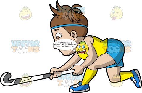 A woman lunging forward to go after a field hockey ball. A woman with brown hair and eyes, wearing blue shorts, a yellow shirt, yellow socks and blue shoes, holds her field hockey stick low to the ground as she lunges forward to go after a ball