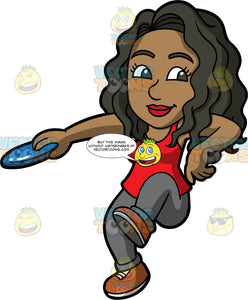 Maggy About To Throw A Frisbee. A black woman wearing dark gray pants, a red tank top, and brown shoes, holding a blue frisbee in her hand and getting ready to throw it