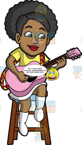 Jackie Playing A Pink Acoustic Guitar. A black woman wearing a white skirt, a yellow shirt, and white boots, sitting on a stool and playing a baby pink acoustic guitar