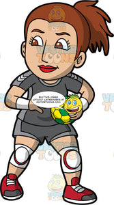 A competitive woman gets ready to start a handball match. A woman with brown hair and brown eyes, wearing a gray handball uniform, white kneepads and red shoes, holds a yellow and green handball in her hand and prepares to start a handball match