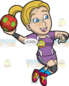 A woman preparing to throw a handball. A woman with dirty blond hair and blue eyes, wearing a purple and white handball uniform, gray kneepads and wrist guards, blue socks and red shoes, holds a red and green handball in her hand and prepares to throw it