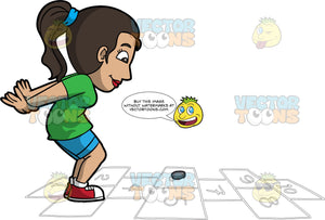 Sporty Woman Playing Hopscotch. A woman with black hair tied in a ponytail, wearing a green shirt, blue shorts, white socks, red with white shoes, smiles as she jumps on numbered rectangles outlined on the ground to play hopscotch