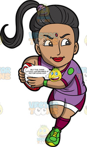 An Indian woman running with a rugby ball. An Indian woman with black hair tied up in a ponytail, wearing purple and burgundy shorts, a purple and burgundy shirt, burgundy socks, and green rugby cleats, runs with a red and white rugby ball in both hands