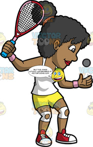 A Black Woman Getting Ready To Serve A Squash Ball. A black woman, wearing yellow shorts, a white tank top, and red shoes, throws a squash ball up with one hand and holds a squash racquet in the other, as she prepares to serve the ball