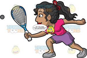 A Woman Playing A Game Of Squash. A woman with light brown skin, and black hair tied in a ponytail, wearing purple shorts, a pink t-shirt, and gray shoes, holding a squash racquet in one hand and trying to hit a squash ball coming towards her