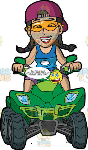 A Woman Having Fun Riding Her Green Quad Bike. A woman with her hair in braids, wearing purple shorts, a blue tank top, and plum baseball cap worn backwards, smiles as she drives a bright green all terrain vehicle