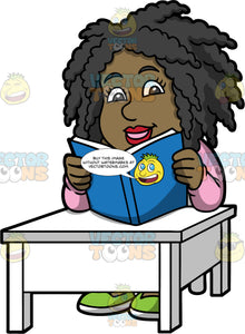 Lisa Reading A Good Book. A black woman wearing a pink sweater, sitting at a white table and reading a book with a blue cover